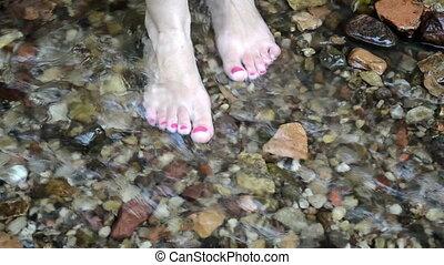 barefoot girl water flow