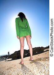 barefoot green dress woman
