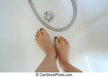 barefoot in bathtub