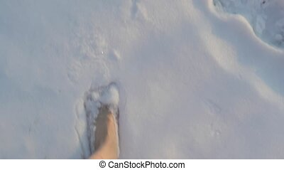 Walking barefoot in snow, first person point of view