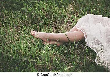 barefoot woman legs on grass