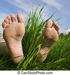 Barefooted a foot in a years grass