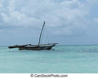 Barge in blue ocean