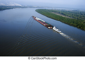 Aerial of barge on Mississippi River in Baton Rouge, Louisiana.
