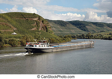 Barge on Rhine River - Barge floating down Rhine River in ...