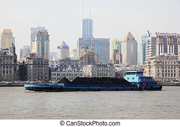 Barge on the Huangpu river in Shanghai, China