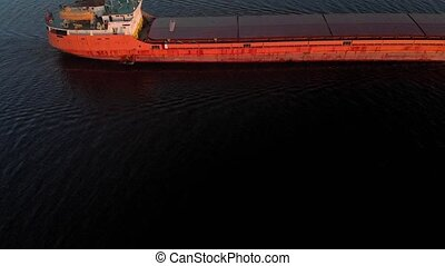 Barge on the river. Summer day.Aerial shoot - Red barge on...