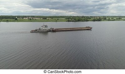 Barge on the river Volga - Aerial view:Barge with cargo on...