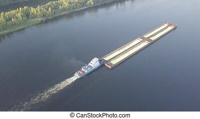 Barge river aerial - Barge with granular cargo on the river....
