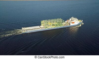 Barge river aerial - Barge with industrial consruction cargo...