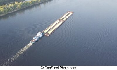 Barge river aerial - Barge with loose cargo on the river....