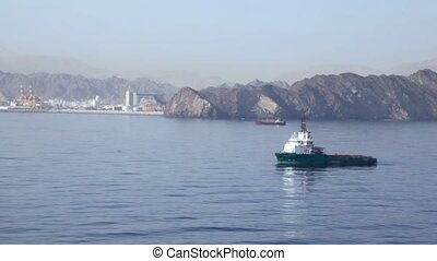 barge sailing in Gulf of Oman, view from cruise ship
