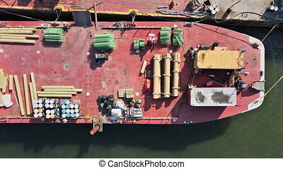 Barge the on a construction vessel in the building pipes and metal structures cargo passage of ships and barges