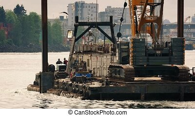 Barge Transporting Crane In Harbor - Barge carrying large...