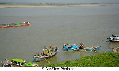 Barge transporting goods by river near small boats. - Video...