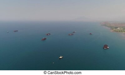 barge with coal in the sea - aerial view barges full coal...