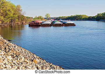Barges along river banks - barges docked along banks of ...