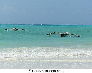 Barges in blue ocean