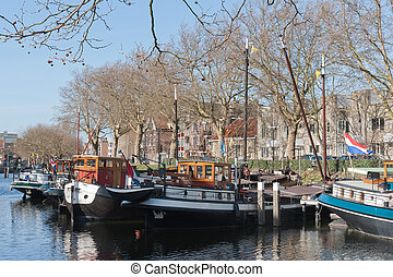 Barges in old historic harbor of Schiedam, The Netherlands