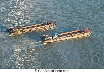 Barges On Huangpu River, Shangha, China, at Sunset