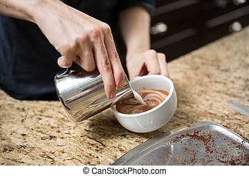 Barista Making Cappuccino In Coffeeshop