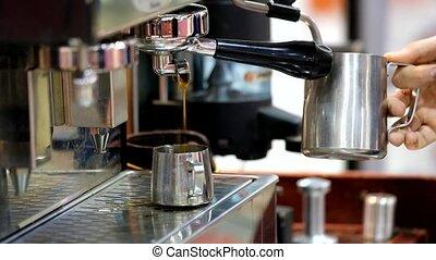 Barista making cappuccino using coffee machine - Barista...