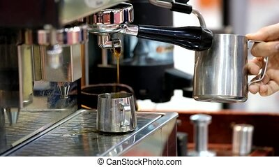 Barista making cappuccino using coffee machine - Barista...