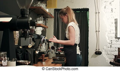 Barista making coffee with proffessional brewing coffee bar....