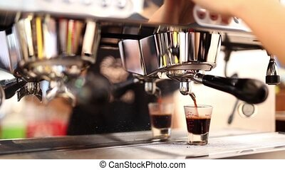 Barista making fresh coffee from coffe machine