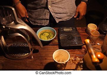 Barista making green tea ingredient for green tea latte