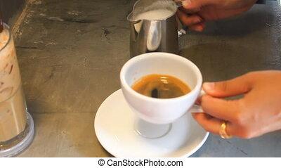 Barista making single shot of latte - Barista making single...