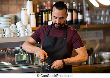 barista man making espresso at bar or coffee shop -...