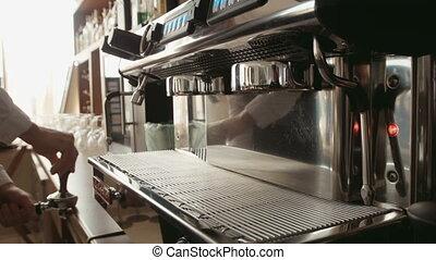 Barista prepares espresso in a coffee machine - Barista in...