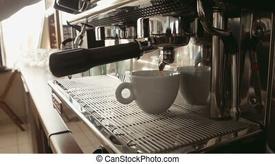 Barista prepares espresso in a coffee machine