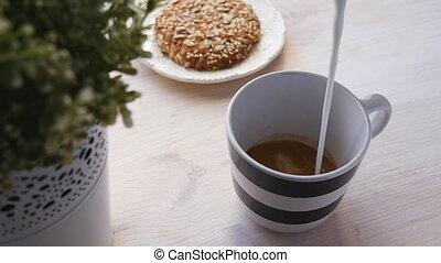 Barista prepares latte in a cup slowmotion - Barista...