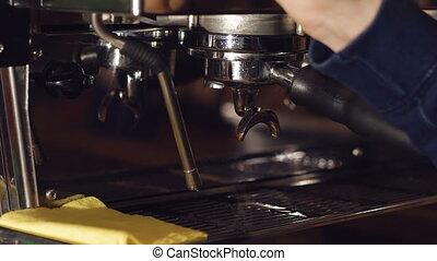 Barista preparing beverage in coffee maker. Full HD