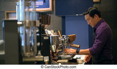 Barista preparing coffee in cafe 4k - Young barista...