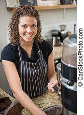 Barista Preparing Coffee In Cafe