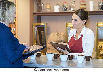 barista recording formula of great taste coffee in clipboard