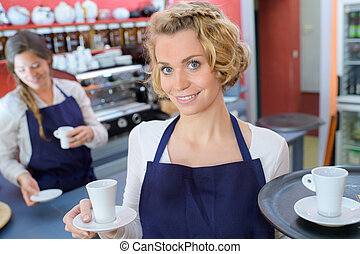 barista serving client give glass tea coffee shop bar counter