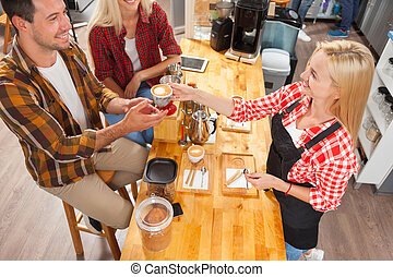 Barista serving clients give cup coffee shop bar counter