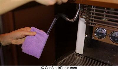 Barista spawns a steam pipe in a coffee machine - A man...