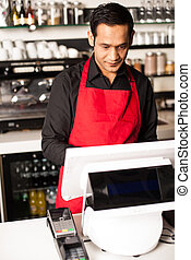 Barista staff at the cash counter
