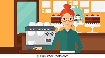 Barista standing near coffee maker. - A woman standing near...