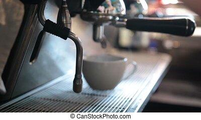 Barista steaming milk to prepare cappuccino - Closeup...