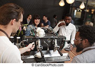 Barista training at an espresso machine in coffee shop