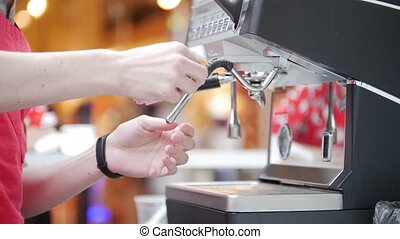 Barista working with a coffee machine in a coffee shop....