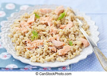 barley groats in a plate - barley groats with salmon in a ...