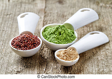 Barley or wheat grass powder, red quinoa and maca powder