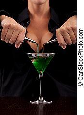 Barmaid mixing drink - Barmaid stands behind bar mixing ...